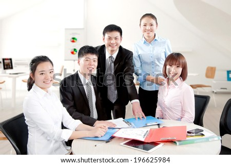 Group of a happy Successful Business People in the office looking at camera. - stock photo