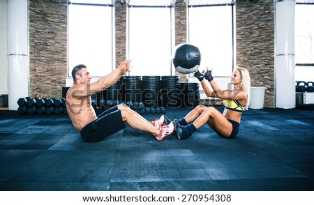 Group of a man and woman workout with fitball at gym - stock photo