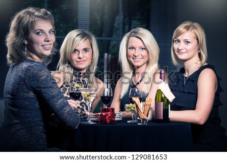 group of a young women in the restaurant
