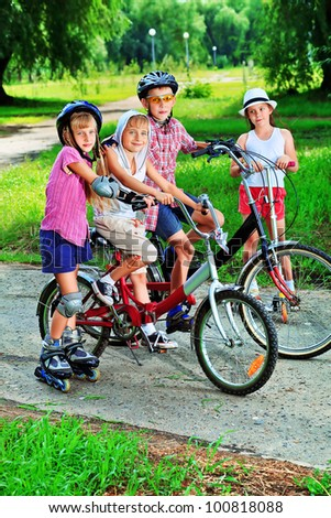 Group of active children in a summer park. - stock photo