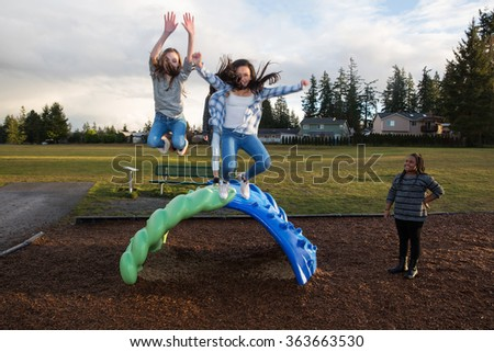 group of active children jumping and playing outside at school p - stock photo