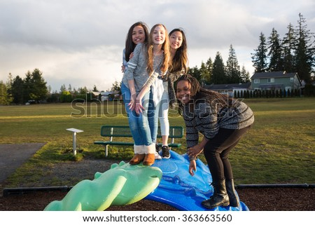 group of active children playing outside at school playground - stock photo