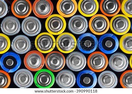 Group of alkaline batteries as background