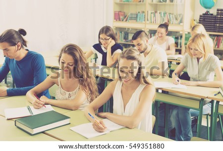 Group of american adult students working in a cozy classroom