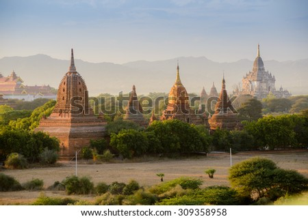 group of ancient pagodas in Bagan at the sun set, myanmar - stock photo