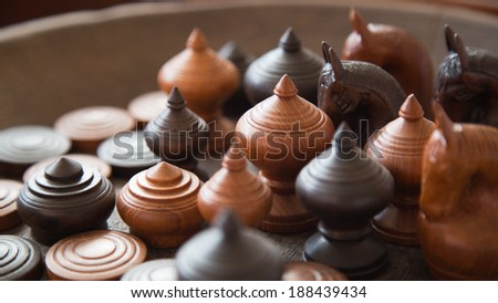 Group of ancient Thai wooden chess with natural lighting, Home decoration - stock photo