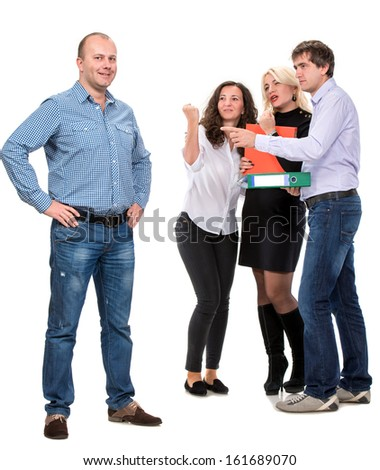 Group of angry business people with businessman leader on foreground - stock photo