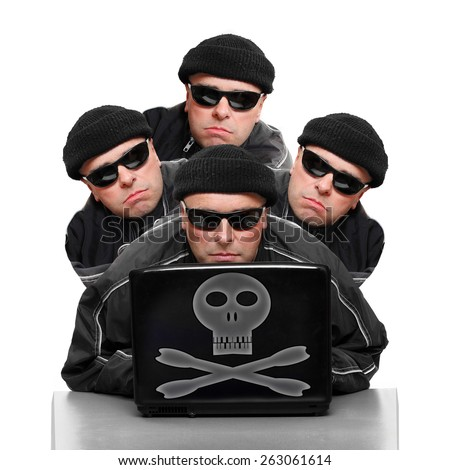Group of anonymous hackers or terrorists with laptop. - stock photo