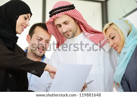 Group of Arabic business people at work - stock photo
