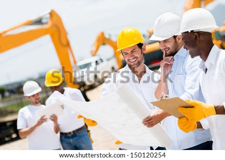 Group of architects and engineers at a building site looking at blueprints - stock photo
