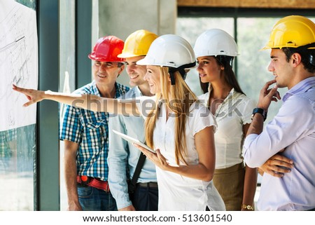 Group architects experts discuss about construction stock photo group of architects and experts discuss about construction projectlooking blueprint of new project malvernweather Images