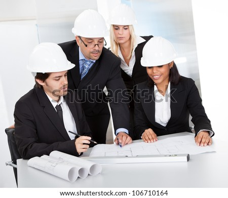 Group of architects at the meeting discussing the project - stock photo