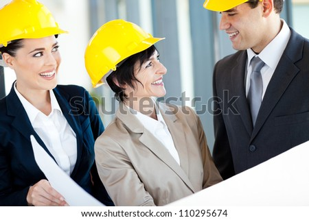 group of architects discussing construction project - stock photo