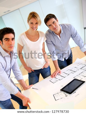 Group of architects working in office - stock photo