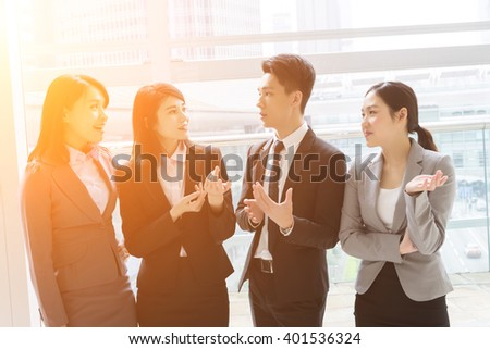 group of Asian business man and woman talk to each other - stock photo