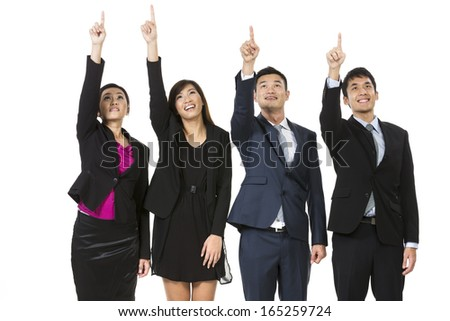 Group of Asian business people pointing at something. Raising their hands up and showing. Isolated on white background.