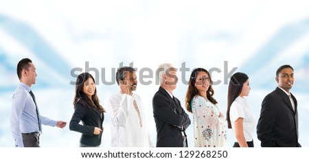 Group of Asian people lined up. Multiracial Asian person queuing up in a line waiting patiently. - stock photo