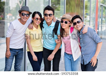 Group of Asian people wearing sunglasses - stock photo