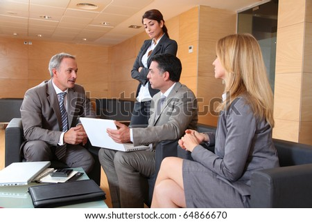 Group of associates meeting in lounge - stock photo
