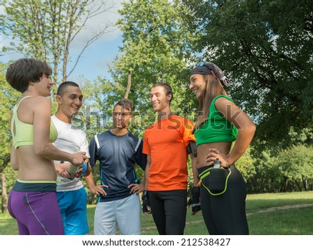 Group of athlete talking after exercise.