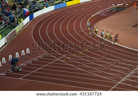 Group of athletes running on professional race before olympic game in rio - stock photo