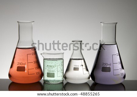 group of beakers with liquid multi with a white background