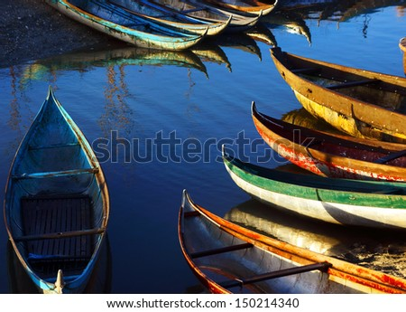 Group of Beautiful colorful wooden boat on lake in sunlight morning - stock photo