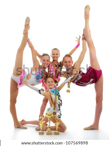 Group of beautiful gymnasts  holding a winners cup