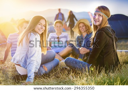 Group of beautiful teens camping at summer festival - stock photo