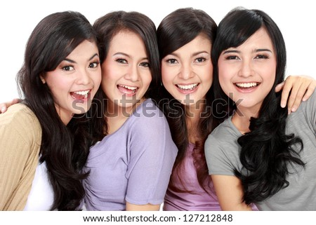 Group of beautiful women smiling isolated over a white background - stock photo