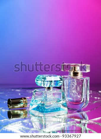 Group of beauty glass bottles on colorful red blue background