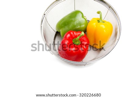 Group of Bell peppers in a kitchen cullender - stock photo