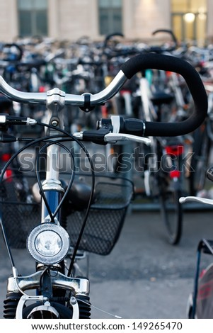 Group of bicycles in city environment - stock photo