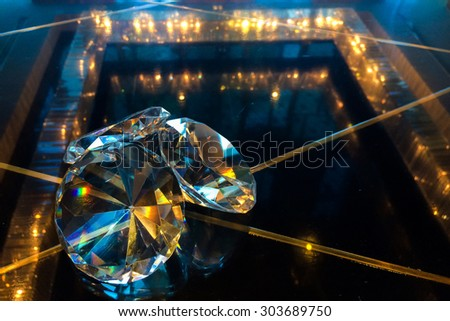 Group of Big Diamonds Shining on Reflection Black Glass Table at The Corner used as Template - stock photo