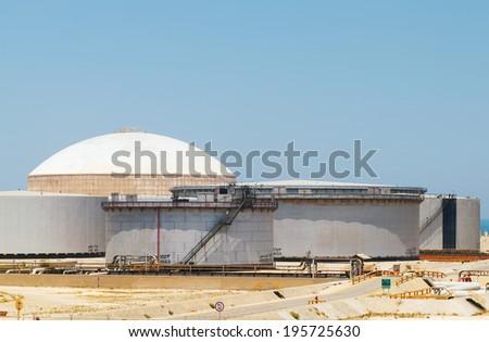 Group of big fuel tanks. Ras Tanura oil terminal, Saudi Arabia - stock photo