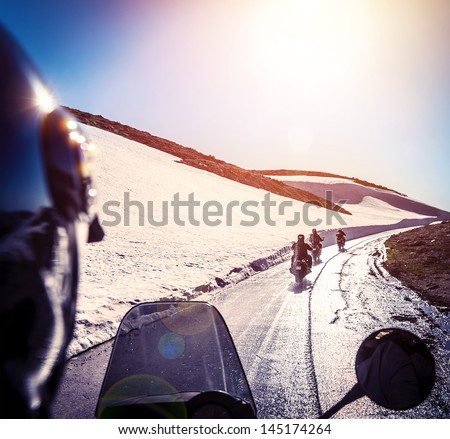 Group of bikers on snowy road, active lifestyle, adventure trip, extreme  moto sport, off-road transport, race competition, speed concept - stock photo