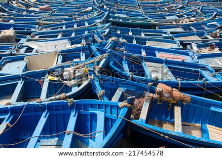 Group of blue fishing boats aligned in the harbour of Essaouira, Morocco - stock photo
