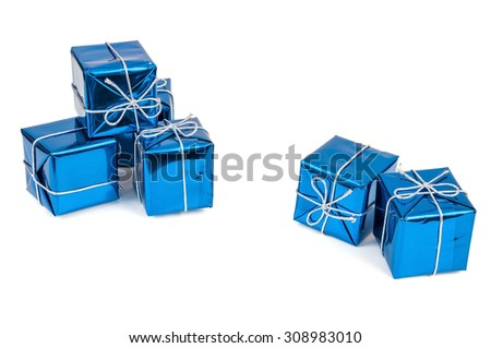 Group of blue gift boxes with silver ribbons isolated on white background with clipping path - stock photo