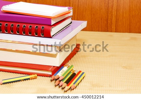 group of books and pencil on wooden,desk