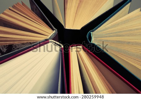 Group of books on light background, top view - stock photo