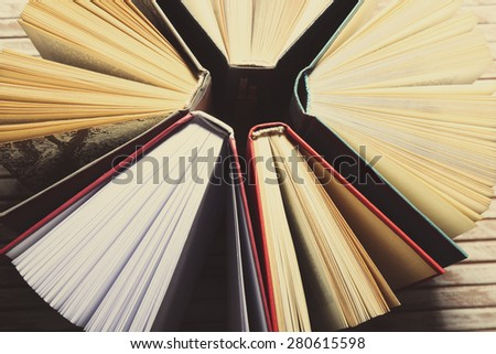 Group of books on wooden background, top view - stock photo
