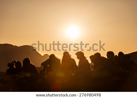 Group of Boy Scouts at sunset in the mountains - stock photo
