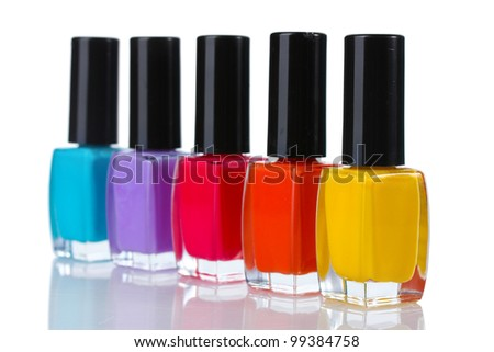 Group of bright nail polishes isolated on white - stock photo