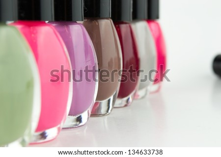 Group of bright nail polishes on white - stock photo