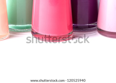 Group of bright nail polishes on white background - stock photo