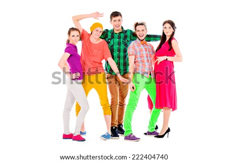 Group of bright young people standing together. Isolated over white. - stock photo