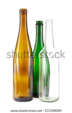 Group of brown, green and clear white glass bottles on white - stock photo