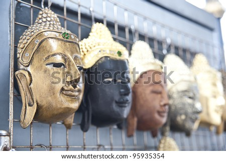 Group of Buddha Face Mask Ornament - stock photo