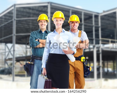 Group of builders workers. Construction industry background. - stock photo