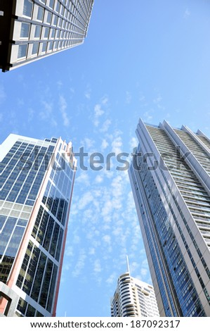 Group of buildings in the city on blue sky background
